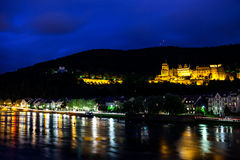 Heidelberg at night. Castle in Heidelberg ( Germany ) from across the river Stock Photo
