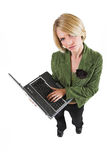 Heidi Booysen #25. Business woman green jacket, standing, holding a laptop royalty free stock photos