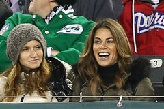 Heidi Rhoades, Jillian Michaels. EAST RUTHERFORD, NJ - NOV 22: Jillian Michaels R and Heidi Rhoades attend the game between the New York Jets and New England royalty free stock photography