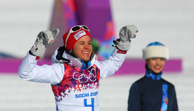 Heidi WENG. Sochi, RUSSIA - February 8, 2014: Heidi WENG (NOR) on a flower ceremony after ladies' Skiathlon 7.5 km Classic + 7.5 km Free of Sochi 2014 XXII Royalty Free Stock Images