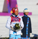 Heidi WENG. Sochi, RUSSIA - February 8, 2014: Heidi WENG (NOR) on a flower ceremony after ladies' Skiathlon 7.5 km Classic + 7.5 km Free of Sochi 2014 XXII Stock Photo