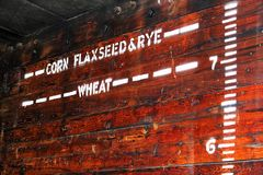 Height indicators for various grains in an old grain car.  stock photography
