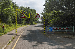 Height restriction on a road leading to a park Stock Image
