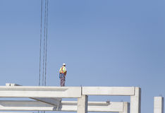 Height worker on building skeleton Stock Image