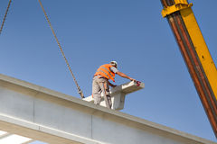 Height worker placing truss in skeleton Stock Images