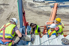 Height workers in cherry picker are working on new metal canopie Stock Image