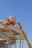 Height workers with help of cherry picker are working on new met Stock Image