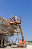 Height workers with help of cherry picker are working on new met Royalty Free Stock Images