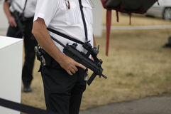 Heightened security. Heavily armed law enforcement offers in shallow DOF stock photos