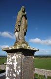 Heilig beeldhouwwerk buiten Rots van Cashel in Ierland Stock Foto