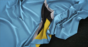 Heilig-Lucia Flag Wrinkled On Dark-Hintergrund 3D übertragen Stockbild