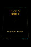 Heilige Bijbel in androïde stock fotografie