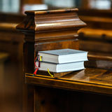 Heilige book on the church bench Stock Photography
