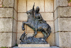 Heilige George en de draak, bronsbeeldhouwwerk, Caceres, Extremadura, Spanje Royalty-vrije Stock Foto's