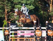 HEILIGE 05 PETERSBURG-JULI: Rider Maxim Kryna op Klooney 26 in CSI Royalty-vrije Stock Foto