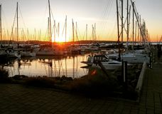 Heiligenhafen -. Rising sun in yacht Port Royalty Free Stock Photography