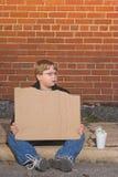 Heimatloser Junge Stockbild