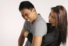 Heimlich - délivrance de jeune femme un homme Photos libres de droits