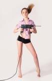 Heimwerken   Frau mit Puncher Lizenzfreie Stockbilder