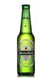 Heineken beer. Bottle with drops isolated on white