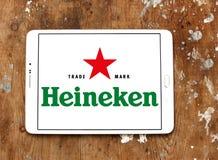 Heineken beer logo. Logo of beer drinks company heineken on samsung tablet on wooden background Royalty Free Stock Image
