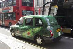 Heineken brännmärkte taxitaxin Royaltyfri Bild