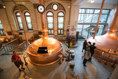 Heineken brewery. SEPTEMBER, 2014: Brewery inside Heineken Experience Museum royalty free stock photo