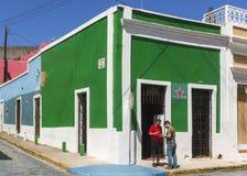 Heineken pub in Old San Juan. SAN JUAN, PUERTO RICO - MARCH 6, 2015: A corner pub has been painted completely in the Heineken green. The red Heineken star is stock images