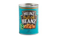 Heinz Baked Beans. HARTLEPOOL, ENGLAND - JANUARY 11, 2014: A can of Heinz baked beans isolated on a white background. Heinz Company manufactures thousands of royalty free stock image
