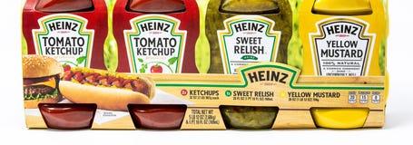 Heinz brand ketchup, yellow mustard and sweet relish. Portland, OR / USA - October 13 2018: Heinz brand ketchup, yellow mustard and sweet relish in plastic stock image