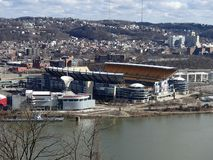 Heinz Field and Carnegie Science Center view from Mt Washington on the Ohio River. Views of Heinz Field and Carnegie Science Center with Cloudy Blue Skies on the stock photos