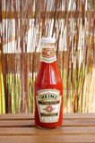 Heinz Ketchup. Large bottle of Heinz ketchup standing on a wooden table stock photography