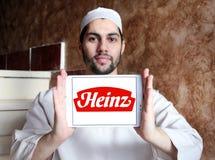 Heinz logo. Logo of heinz company on samsung tablet holded by arab muslim man stock photography