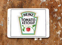 Heinz tomato ketchup logo. Logo of heinz tomato ketchup on samsung tablet on wooden background stock images