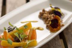 Heirloom Carrots with saffron. Heirloom Carrots with nasturtium crumble & saffron aioli stock image