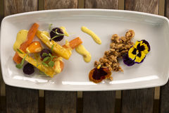 Heirloom Carrots with saffron. Heirloom Carrots with nasturtium crumble & saffron aioli royalty free stock photography