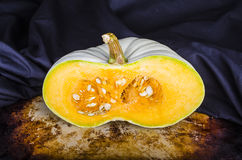 Heirloom Pumpkin Halve on black Royalty Free Stock Photo