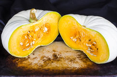 Heirloom Pumpkin Side by Side Halves on black Stock Photo