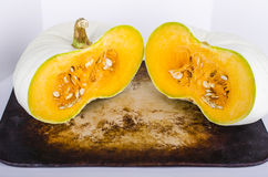 Heirloom Pumpkin Side by Side Halves on white Royalty Free Stock Photography