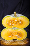 Heirloom Pumpkin Stacked Halves on black Royalty Free Stock Photos