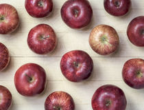 Heirloom Red Delicious Apples. Set in an array on an old worn Maple cutting board Stock Photos