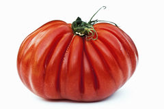 Heirloom tomato. Heirloom/ beefsteak tomato on white background Royalty Free Stock Image