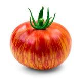 Heirloom tomato. Dragons eye heirloom tomato over white background royalty free stock photos