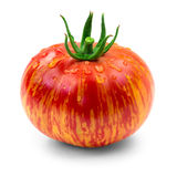 Heirloom tomato. Dragons eye heirloom tomato with water drops over white background stock image