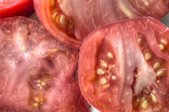 Heirloom tomato. The tomato is the edible, often red fruit/berry of the nightshade Solanum lycopersicum heirloom tomato royalty free stock images