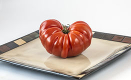 Heirloom tomato. The tomato is the edible, often red fruit/berry of the nightshade Solanum lycopersicum heirloom tomato royalty free stock photography