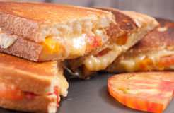 Heirloom tomato and grilled cheese sandwich Royalty Free Stock Photography