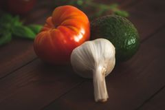 Fresh vegetables on a brown wooden table. stock photos