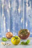 Heirloom tomatoes and basil. Leaves and spices stock photography
