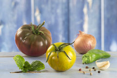 Heirloom tomatoes and basil. Leaves and spices royalty free stock image